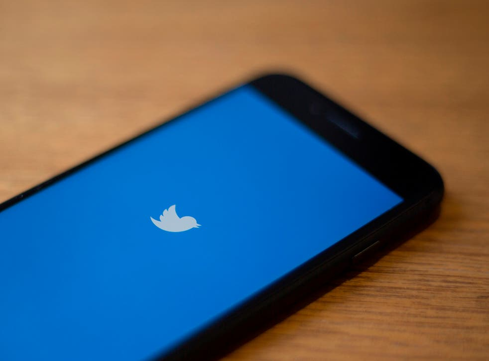 <p>Twitter logo is seen on a phone in this photo illustration in Washington, DC</p>
