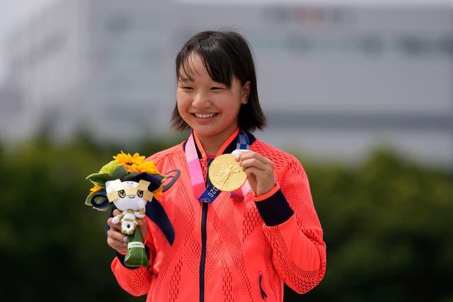 <p>Momiji Nishiya holds her gold medal after winning the Women's Street skateboarding</p>