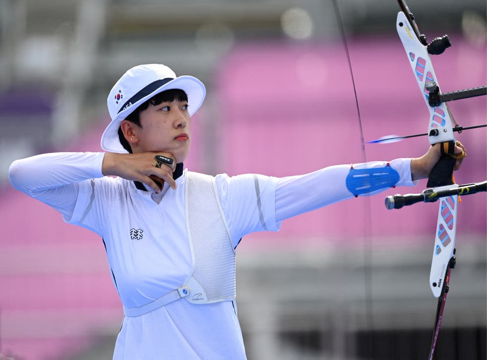 <p>South Korea's An San competes in the women's individual during the Tokyo 2020 Olympic Games at Yumenoshima Park Archery Field in Tokyo on 30 July 2021</p>