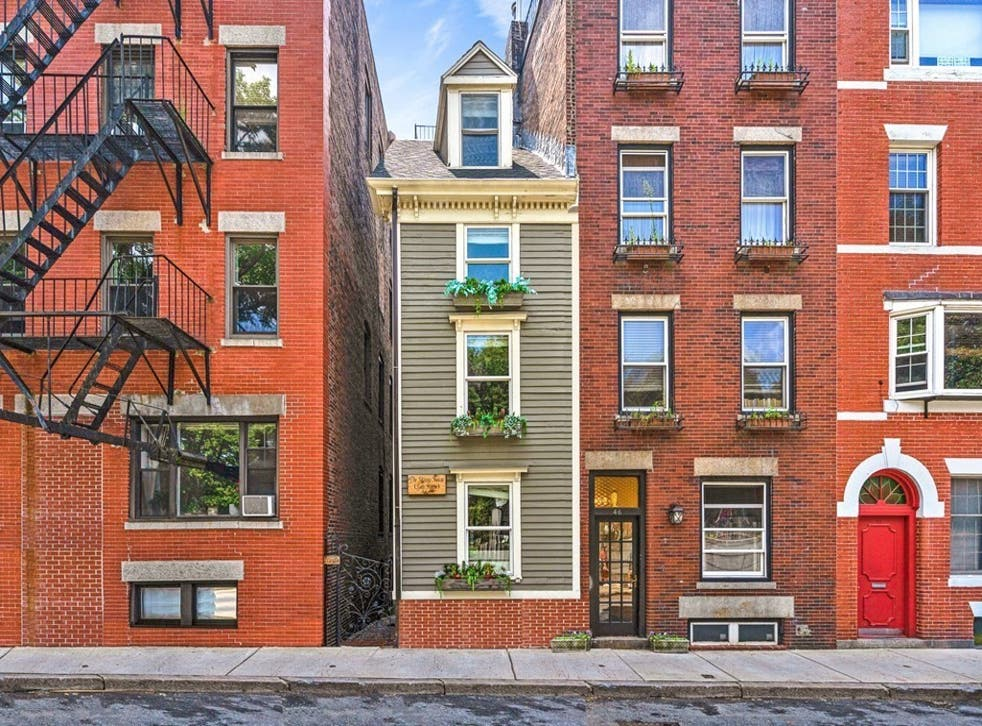 <p>The Skinny House, an iconic landmark property  in Boston's North End, is up for sale on the market for $1.2mn</p>