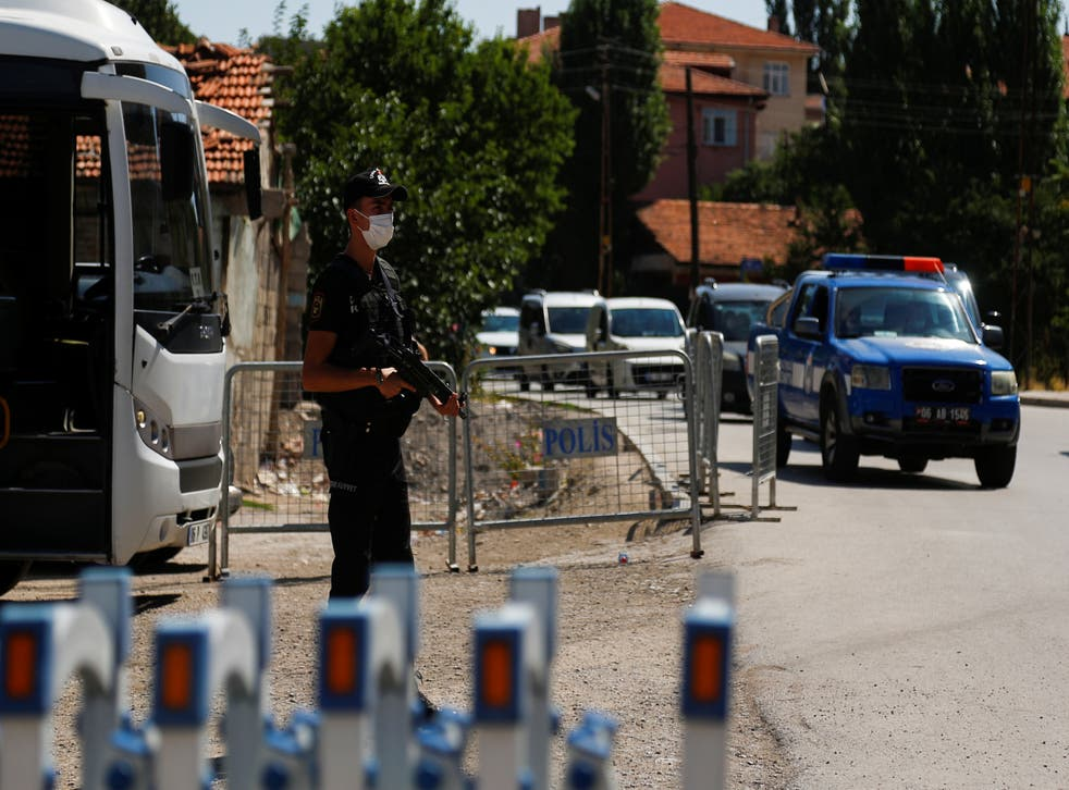 <p>A Turkish riot police member stands guard at a check point on a road which leads to a neighbourhood where many Syrian refugees have houses and shops</p>