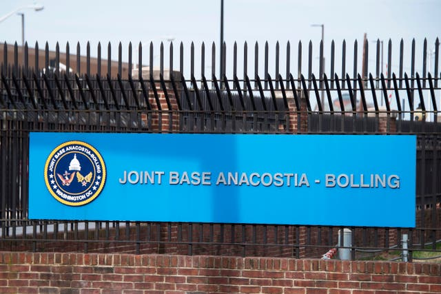 <p>he front gate of Joint Base Anacostia-Bolling is viewed in Washington, DC, on March 27, 2018</p>