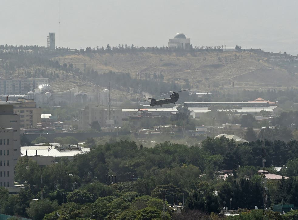 <p>A US military helicopter is pictured flying above of US embassy in Kabul on the day the Taliban entered the capital</p>