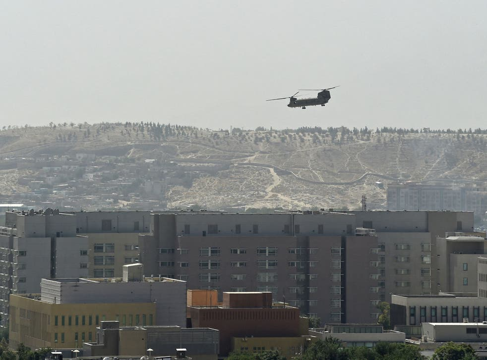 <p>A US military helicopter is pictured flying above the US embassy in Kabul </p>