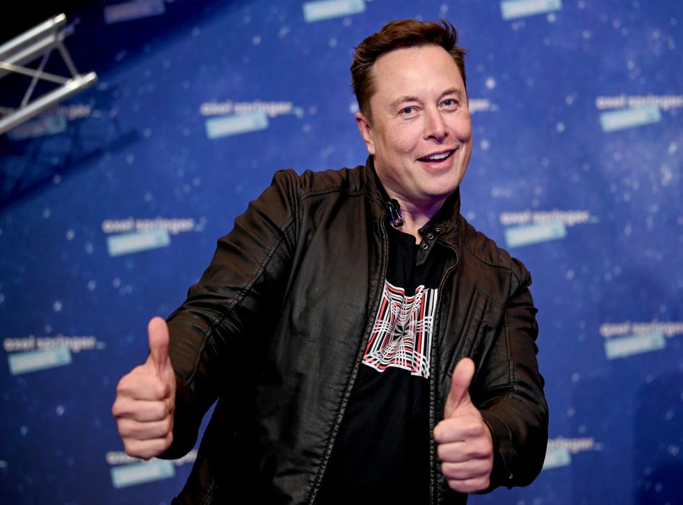 <p>SpaceX owner and Tesla CEO Elon Musk arrives on the red carpet for the Axel Springer Award 2020 in Berlin</p>