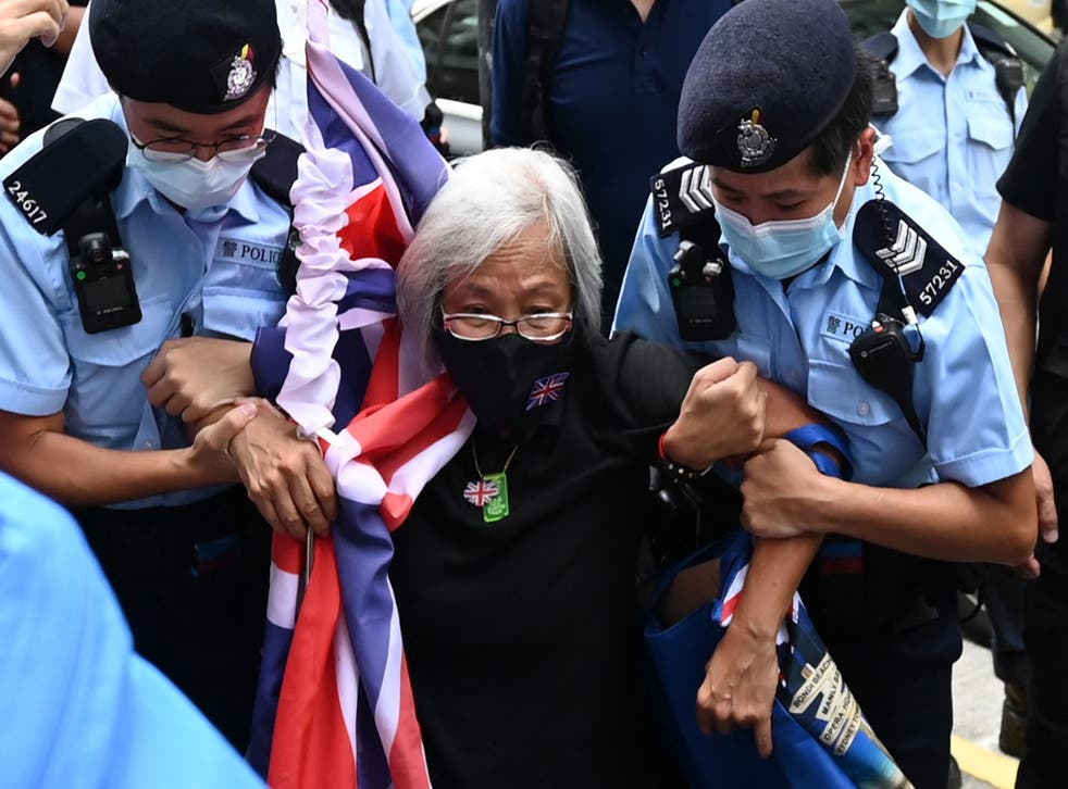 <p>Alexandra Wong, known as Grandma Wong, is taken away by police at a protest last month to mark the 24th anniversary of Hong Kong's handover from Britain</p>
