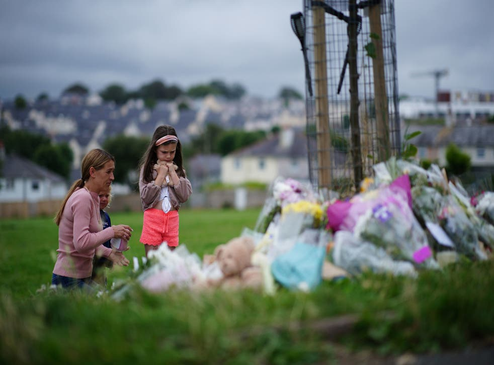 <p>Tributes are laid in Plymouth in August 2021, after Jake Davison killed five people and then turned the gun on himself  </p>