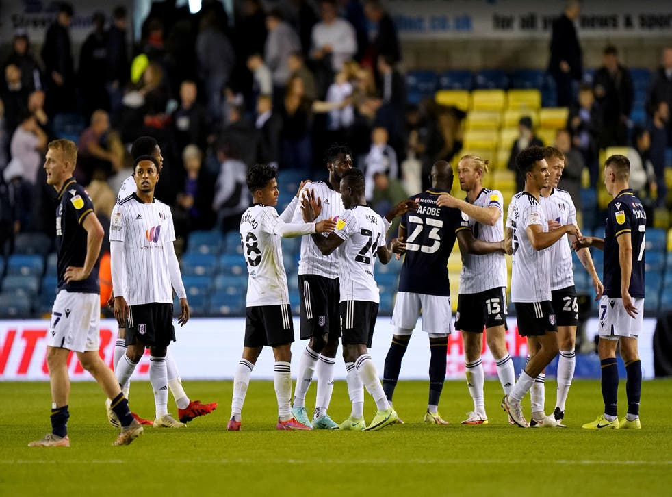 <p>Players hug at the end of the Sky Bet Championship match at The Den</p>