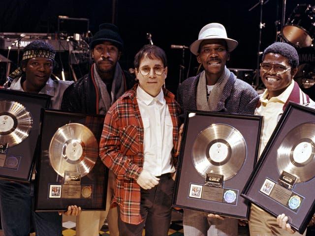 <p>Paul Simon with band and Ladysmith Black Mambazo's Joseph Shabalala (right) </p>