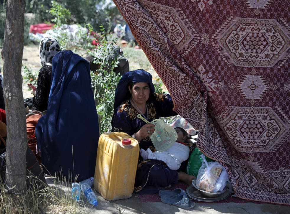 <p>Internally displaced Afghan woman in a park in the capital of Kabul after being forced to escape her home because of conflict between Taliban and Afghan security</p>
