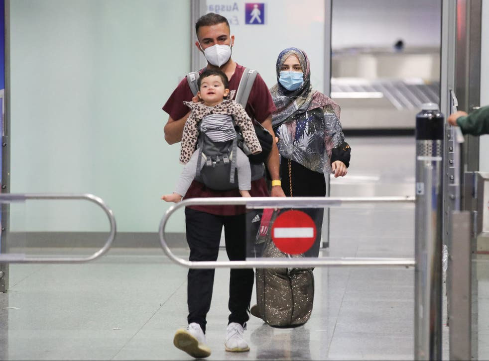 <p>A young family who are among the first evacuees to arrive from Kabul at Frankfurt International Airport on Saturday </p>