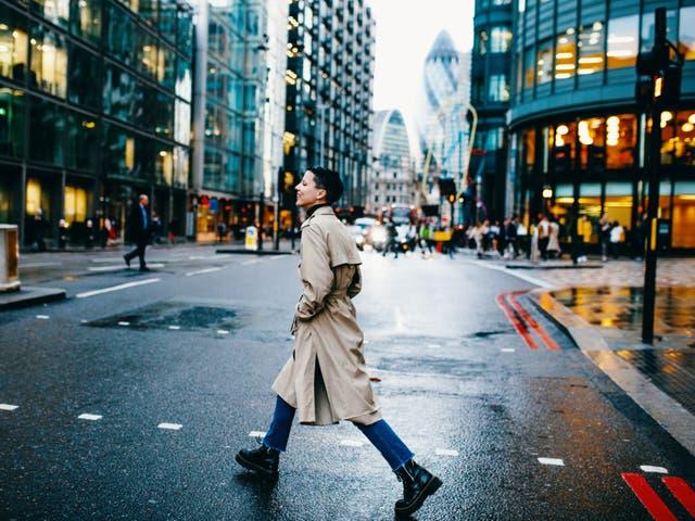 <p>A person walks through London</p>