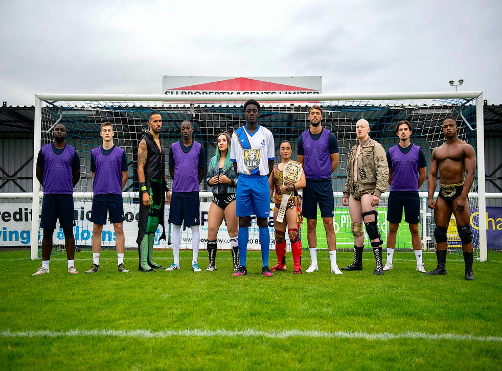 Enfield Town players and WWE NXT UK wrestlers pose following the announcement of their commercial partnership (WWE)