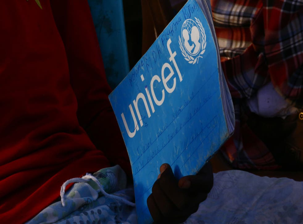 <p>South Sudanese refugees take reading lessons at the UNHCR camp of al-Algaya in Sudan's White Nile state, south of Khartoum</p>