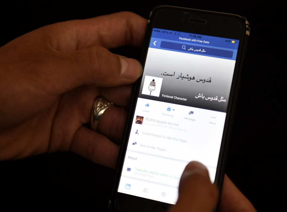 <p>An Afghan university student looks at a meme on a Facebook account in Kabul on January 30 2016</p>