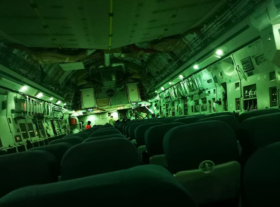 <p>Only a handful of passengers can be seen on a rescue flight leaving Afghanistan, in this image tweeted by Paul Farthing</p>