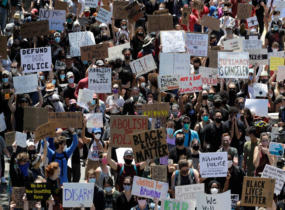 <p>Demonstrators march for Justice in honor of George Floyd in Chicago in June 2020 </p>