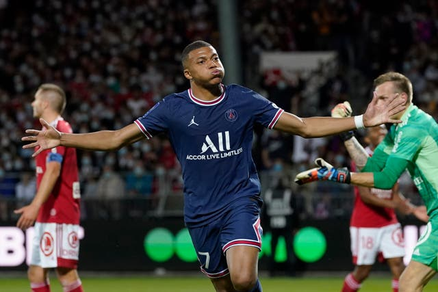 Kylian Mbappe celebrates after scoring for Paris St Germain in their 4-2 Ligue 1 win at Brest (Daniel Cole/AP)