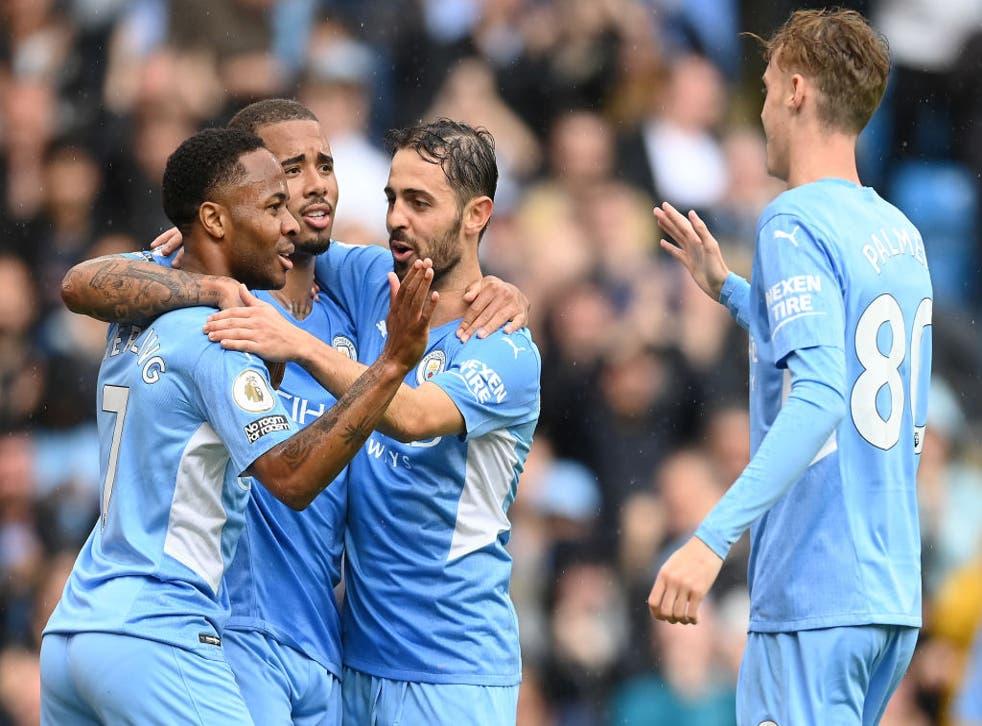 <p>Raheem Sterling celebrates with Gabriel Jesus and Bernardo Silva after scoring City's fourth goal</p>