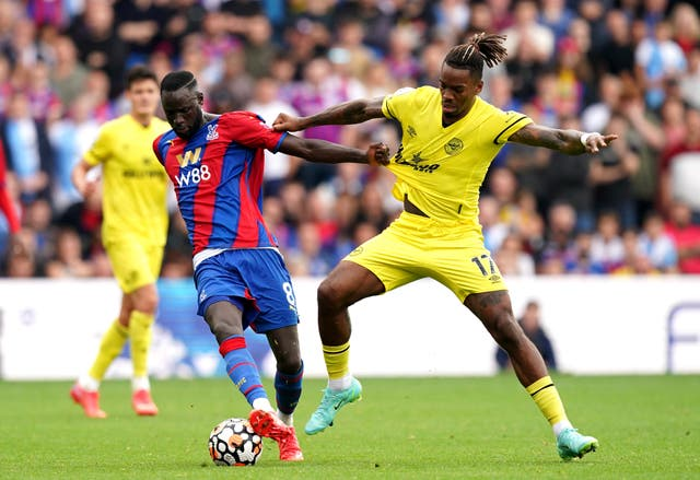 Crystal Palace's Cheikhou Kouyate (left) and Brentford's Ivan Toney battle for the ball (Dominic Lipinski/PA)