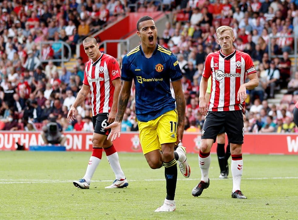 <p>Mason Greenwood celebrates scoring for Manchester United </p>