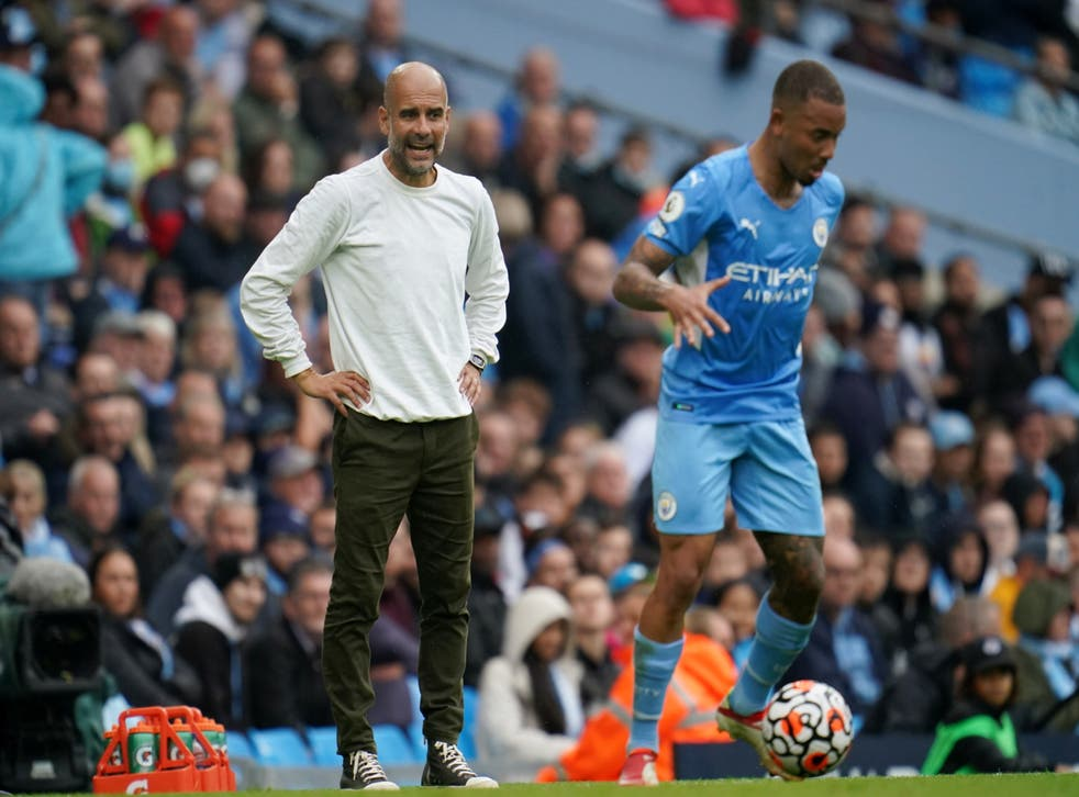 Pep Guardiola, left, does not know whether City will bring in a striker this summer (Nick Potts/PA)