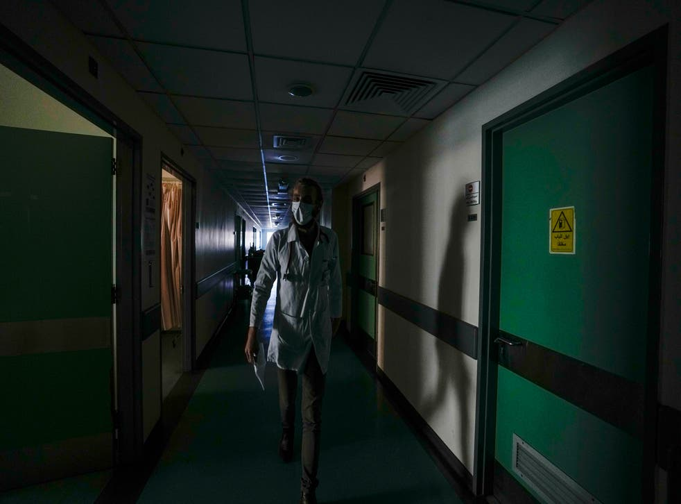 <p>A doctor walks through a corridor of the government-run Rafik Hariri University Hospital during a power outage in Beirut this month </p>