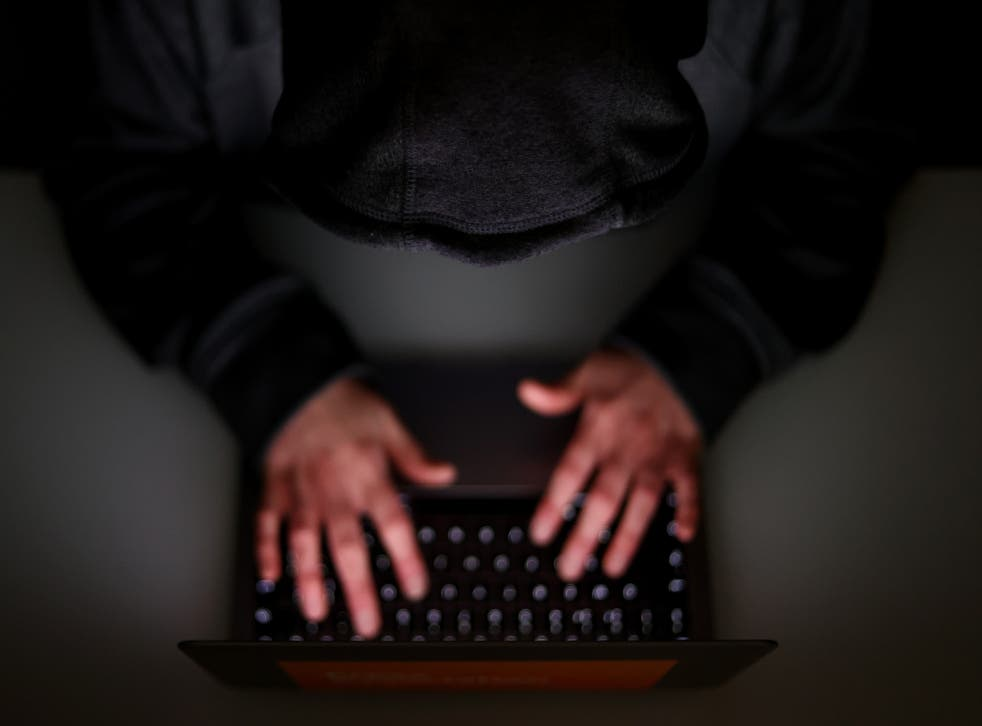 A laptop user with their hood up (Tim Goode/PA)