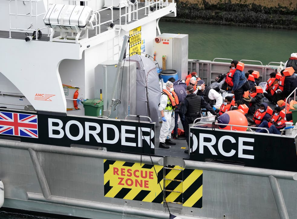 <p>People thought to be migrants are brought into port after being picked up in the English Channel by a British border force vessel on 13 August</p>