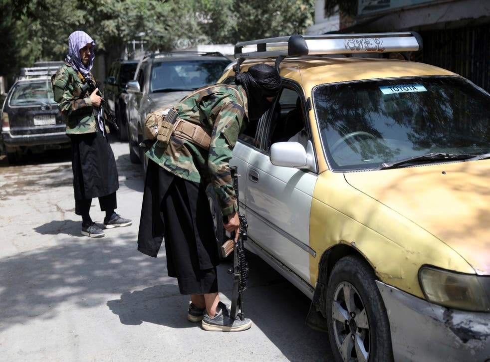 <p>In this 22 August 2021 file photo, Taliban fighters search a vehicle at a checkpoint on the road in the Wazir Akbar Khan neighbourhood in the city of Kabul, Afghanistan</p>