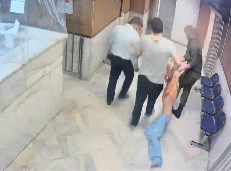 <p>Guards drag an emaciated prisoner at Evin prison in Tehran</p>