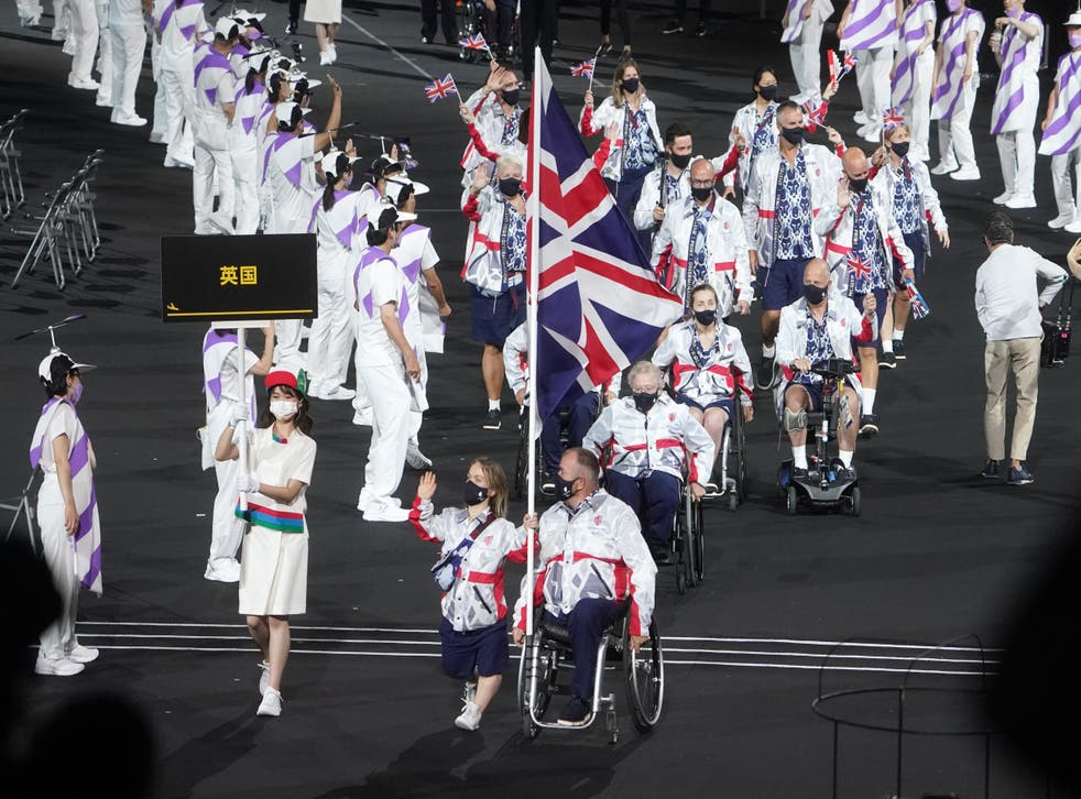 <p>Ellie Simmonds and John Stubbs carried the flag for Great Britain </p>