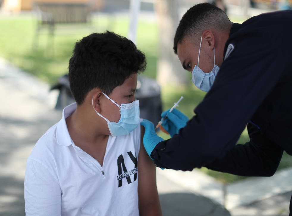 <p>A 12-year-old receives first dose of Covid-19 vaccine in Los Angeles </p>