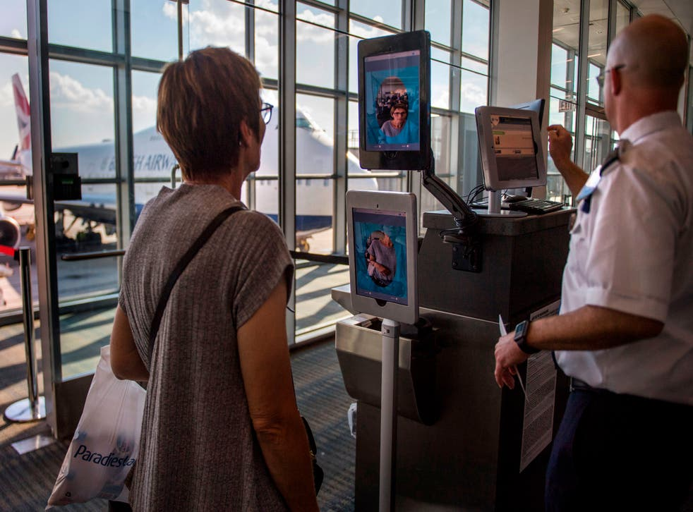 <p>A woman boarding a SAS flight to Copenhagen goes through facial recognition verification system VeriScan at Dulles International Airport in Dulles, Virginia</p>