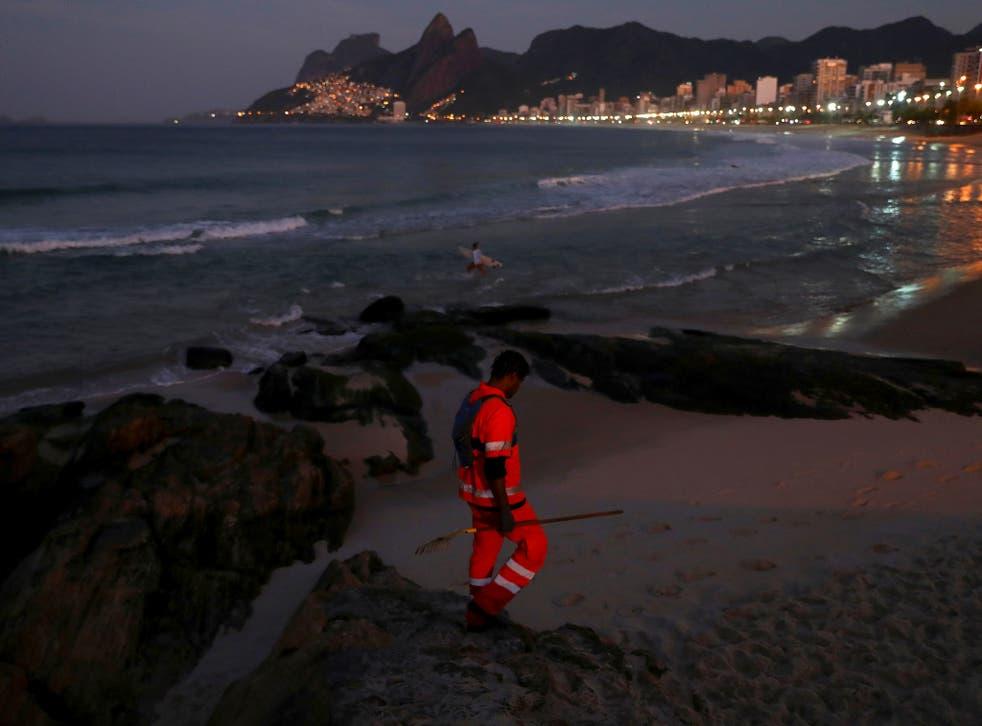 <p>Felipe on patrol along Arpoador beach in Rio picking litter </p>