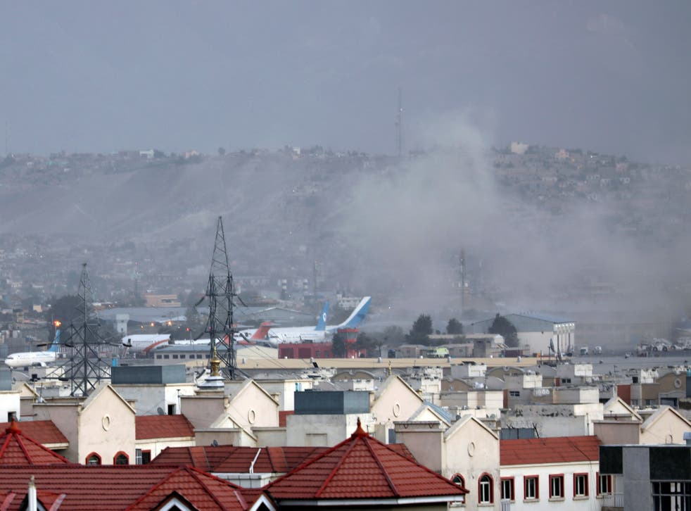 <p>Smoke rises from explosion outside the airport in Kabul</p>