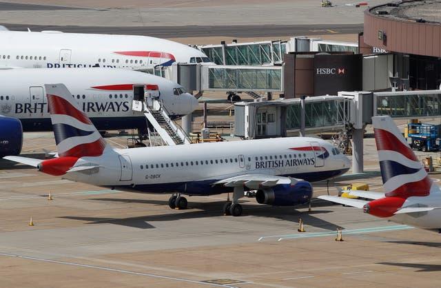 <p>British Airways aircraft parked at Gatwick </p>