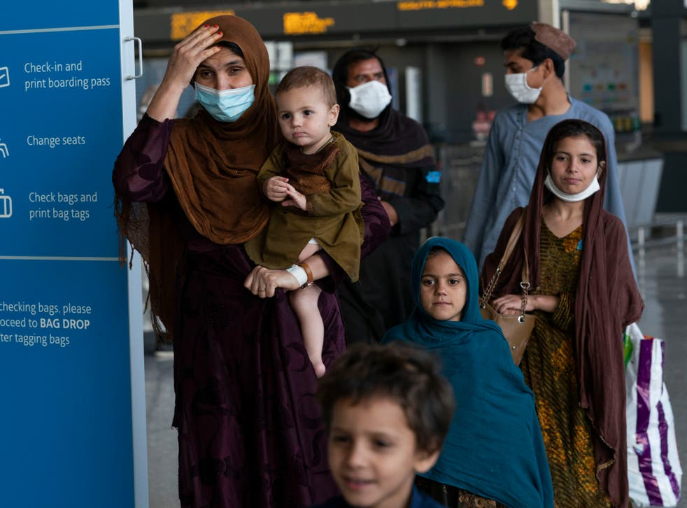 <p>Afghan nationals arriving in Washington after the Taliban takeover </p>