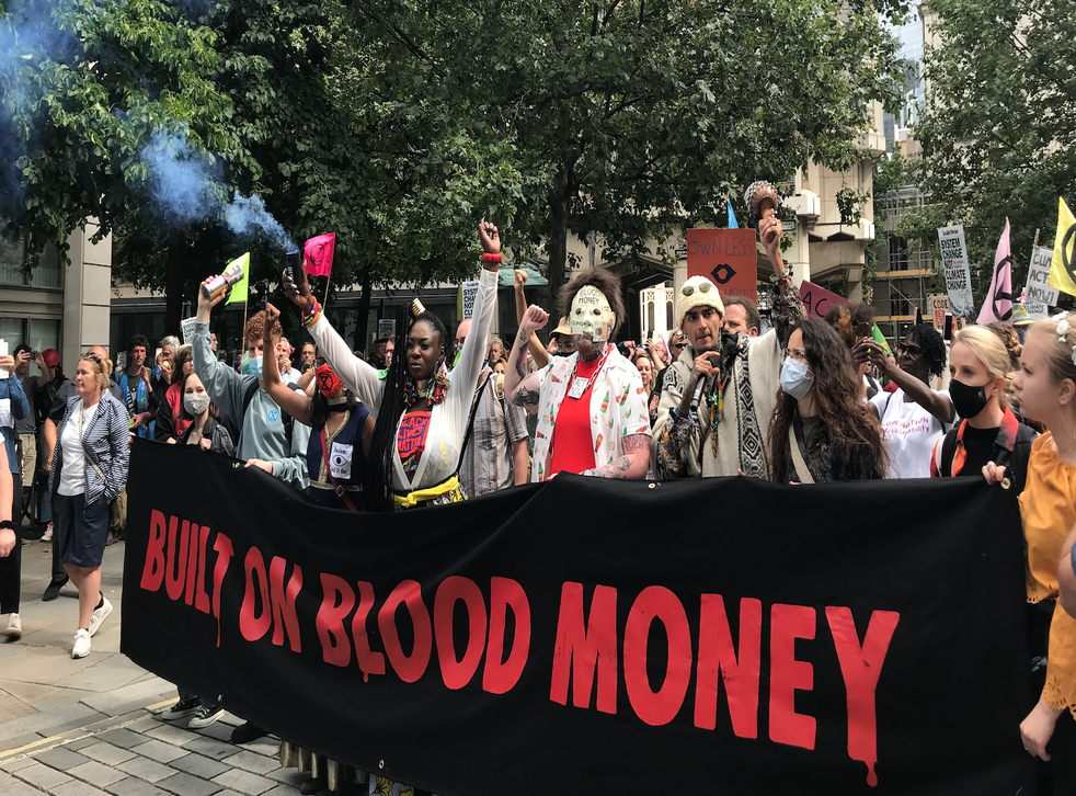 <p>Extinction Rebellion protesters march through the City of London </p>