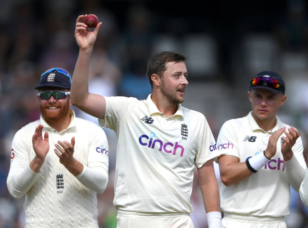 <p>England bowler Ollie Robinson holds aloft the ball after taking his five wickets in the second innings </p>