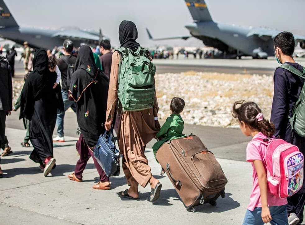 <p>Afghans escaping the Taliban at Kabul Airport</p>