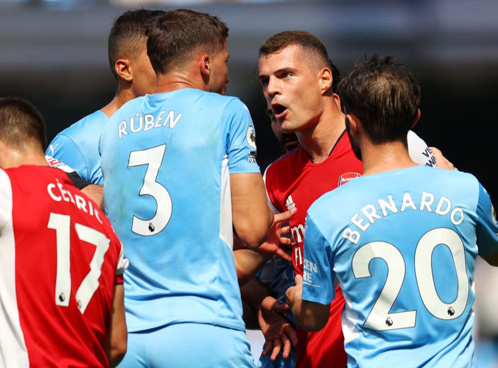 <p>Granit Xhaka argues with Ruben Dias after being sent off </p>