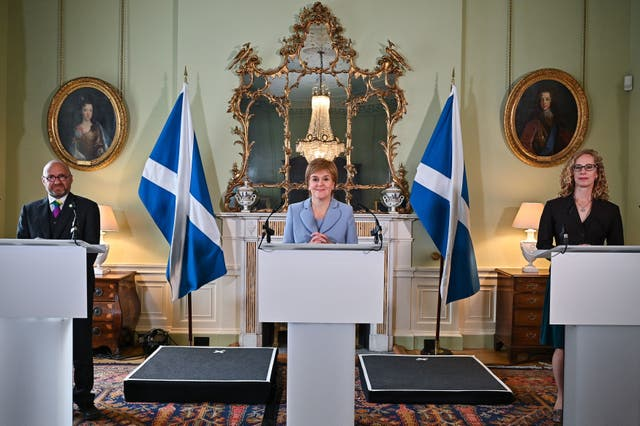 <p>First Minister Nicola Sturgeon with Scottish Green co-leaders Patrick Harvie and Lorna Slater</p>