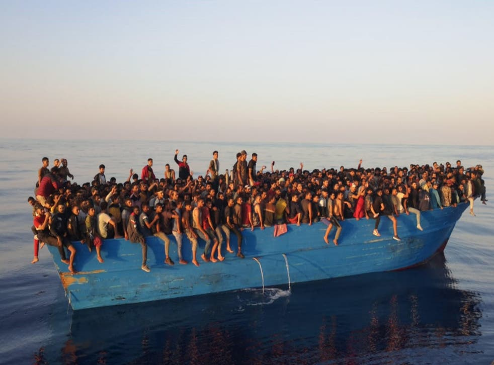 <p>The hundreds of migrants, mainly from countries in North and West Africa, were transferred to patrol boats to be brought to the port of Lampedusa</p>