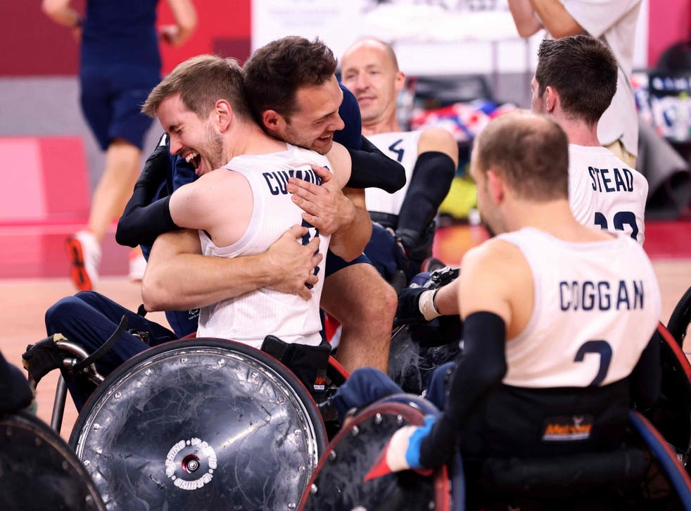 <p>Britain's players celebrate victory in the wheelchair rugby final</p>