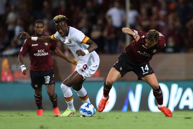 Tammy Abraham, left, and Salernitana's Francesco Di Tacchio battle for the ball (Alessandro Garofalo/LaPresse via AP)