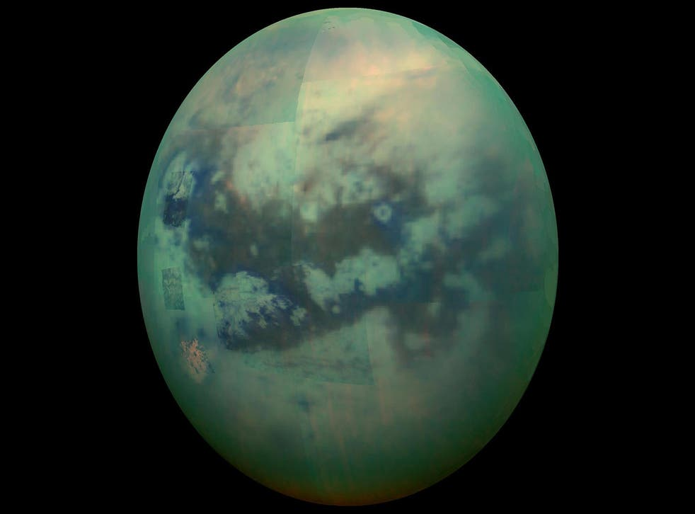 <p>File: A composite image shows an infrared view of Saturn's moon Titan from Nasa's Cassini spacecraft</p>