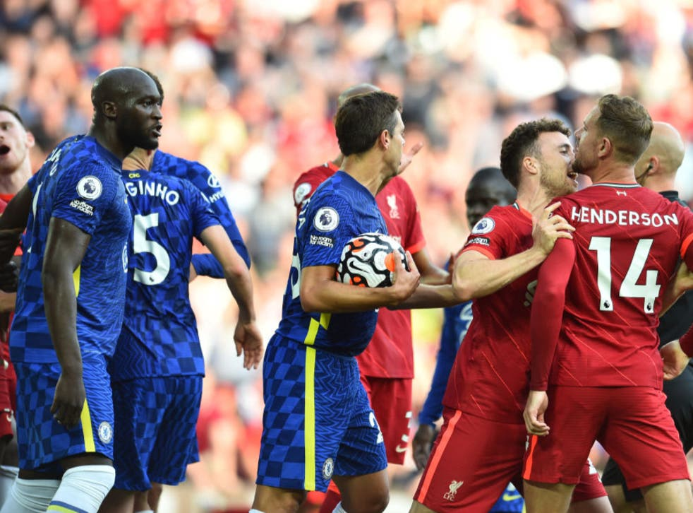 <p>Chelsea and Liverpool players clash at Anfield</p>