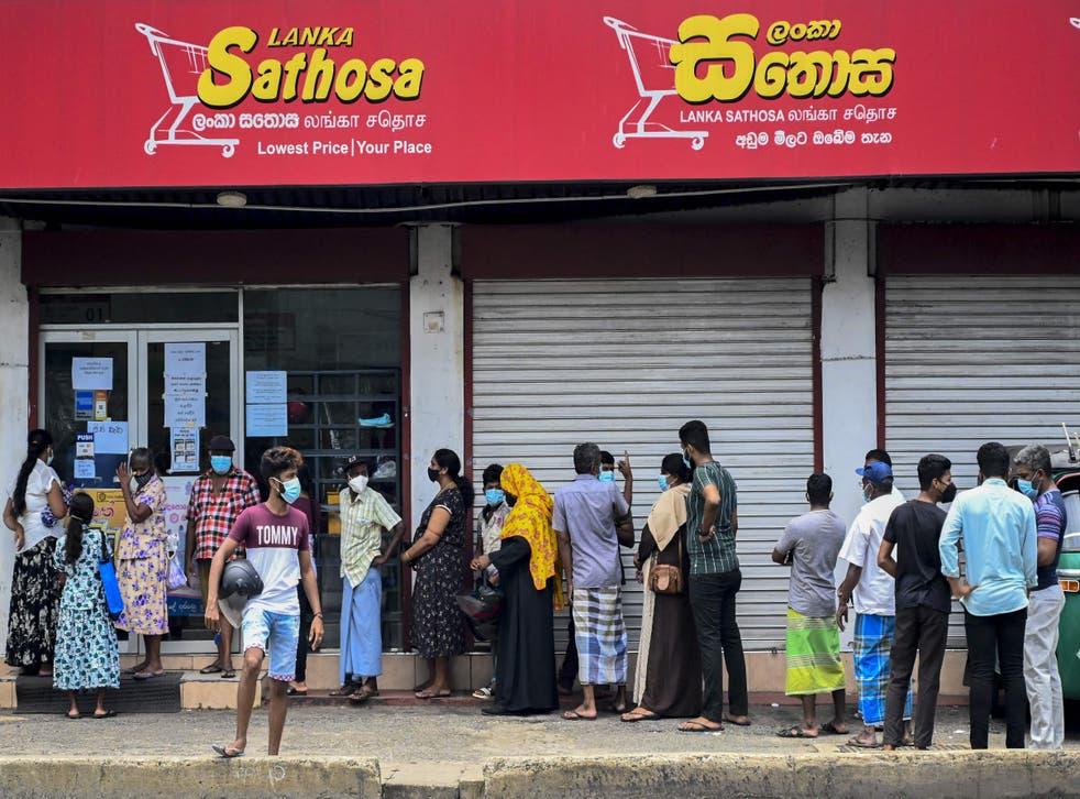 <p>File: People line up outside a supermarket in Colombo, Sri Lanka.</p>
