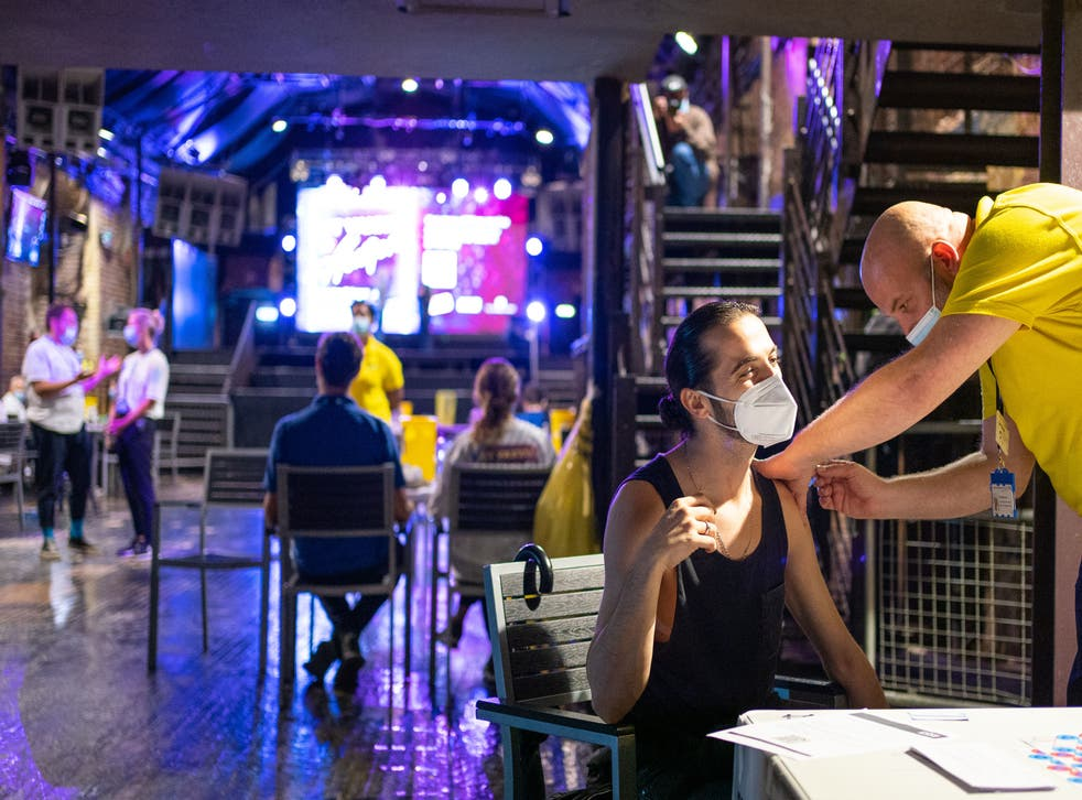 <p>A patient receives a dose of the Pfizer/BioNTech covid vaccine at Heaven nightclub in central London</p>